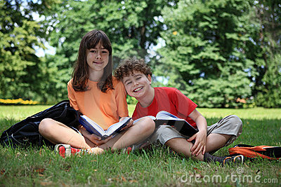 Kids reading books outdoor
