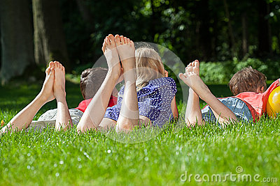 Kids relaxing in park