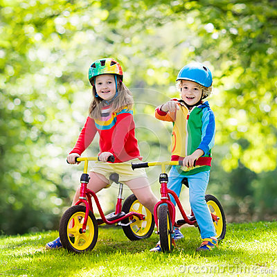 Free Kids Ride Balance Bike In Park Royalty Free Stock Photo - 96099985