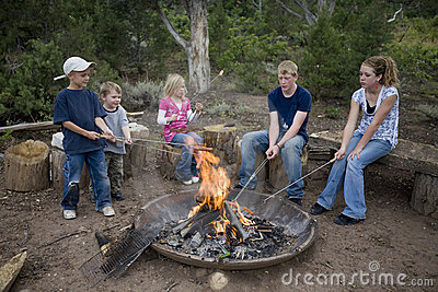 Kids roasting hotdogs