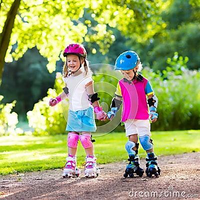 Free Kids Roller Skating In Summer Park Stock Photos - 91541553