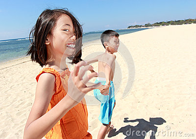 Kids Running In The Beach Royalty Free Stock Photos - Image: 26461028