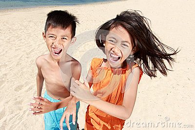Kids running in the beach