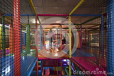 Kids running inside a Colorful indoor playground Stock Photo