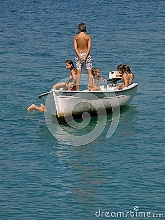 Kids sailng at sea