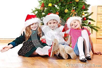 Kids in Santa hats embracing