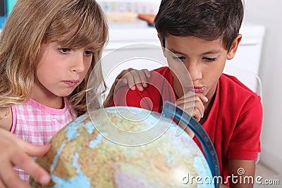 Kids sat with globe