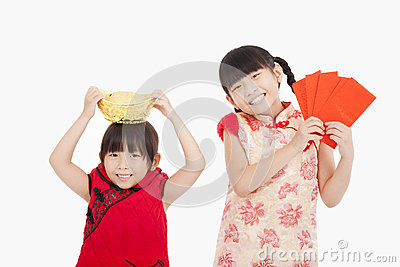 Kids showing red envelope and gold