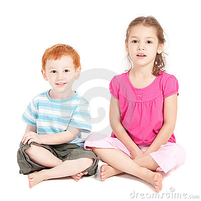 Kids sitting on floor isolated