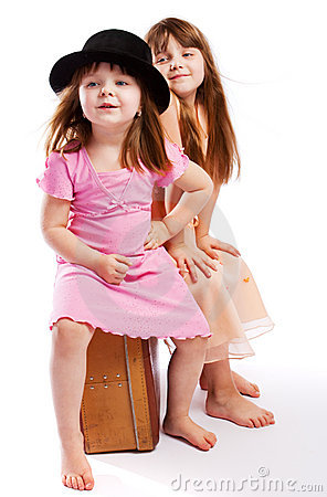 Free Kids Sitting On Suitcase Royalty Free Stock Photography - 9243977