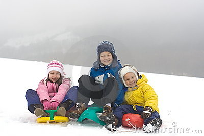 Kids Sliding on Fresh Snow