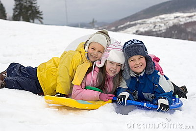 Kids Sliding in Fresh Snow