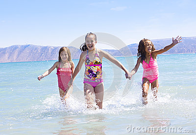 Kids splashing at the beach
