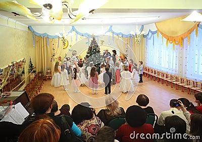 Kids stand around Christmas tree Editorial Stock Photo