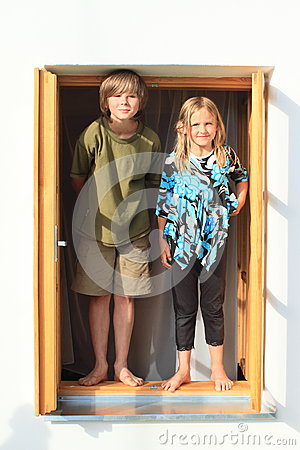 Kids standing on the window