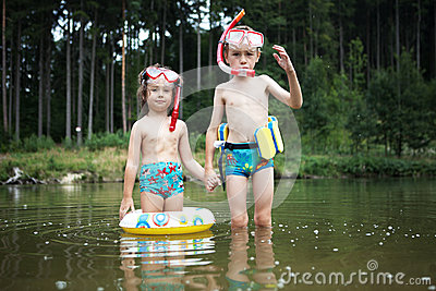 Kids swimming at pond