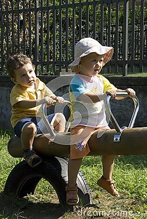 Kids on swing in the park