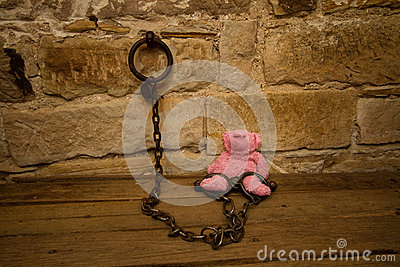 Kids teddy bear prisoner in jail chains