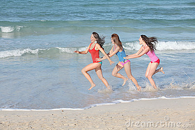 Kids, teens running on beach vacation