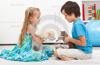 Kids with their pets - dog and cat
