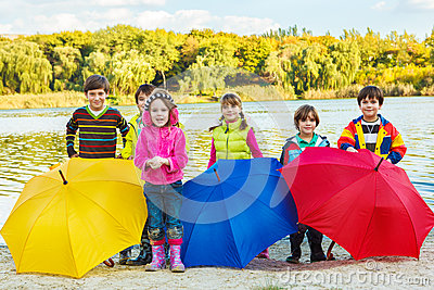 Kids with umbrellas