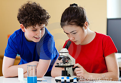 Kids using microscope