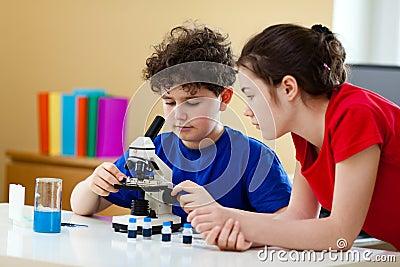 Kids using microscope