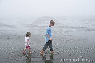 Kids walking at low tide, foggy day