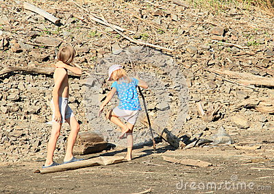 Kids walking in mud