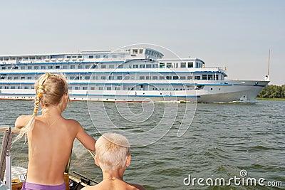 Kids watching the big cruise ship
