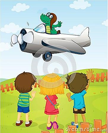 Kids watching crocodile flying plane