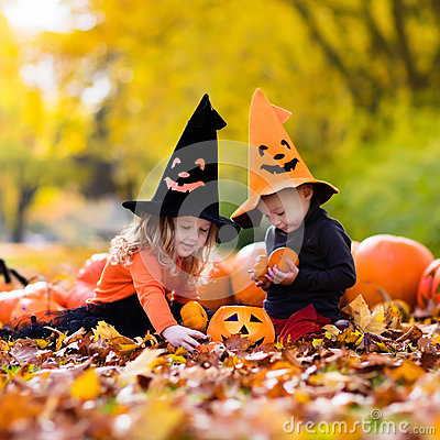 Free Kids With Pumpkins On Halloween Stock Images - 75756744