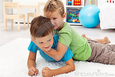 Kids wrestling on the floor