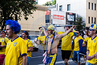 KIEV, UKRAINE - JUNE 11: Cheering Sweden fans go to stadium befo Editorial Image