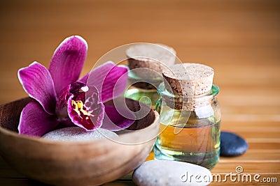 Kiezelstenen, orchidee en oliën