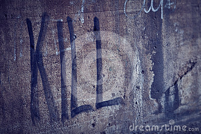Kill Spray Lettering in a Grunge Wall