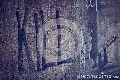 Kill Spray Lettering in a Grunge Wall