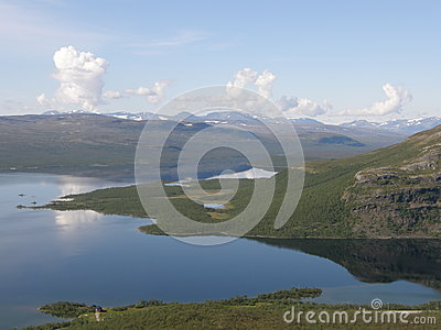 Kilpisjarvi lake surrounded by hills and mountains