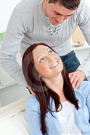 Kind boyfriend massaging his girlfriend s neck