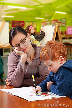 Free Kindergarten Preschool Teacher Helping Children Stock Image - 21714041