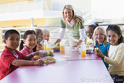 Kindergarten teacher supervising children