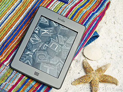 Kindle Touch EReader At The Beach Editorial Photography