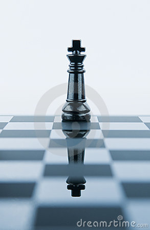 King chess piece reflected in chessboard