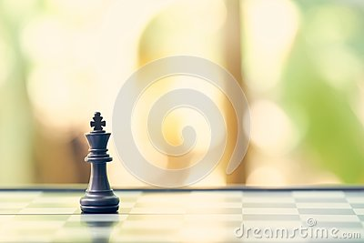 King Chess is placed on a chessboard.using as background business concept and Strategy concept with copy space Stock Photo