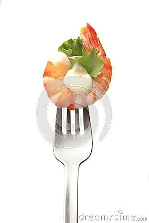 King prawn in a fork