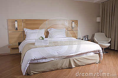 King sized Bed with white flowers