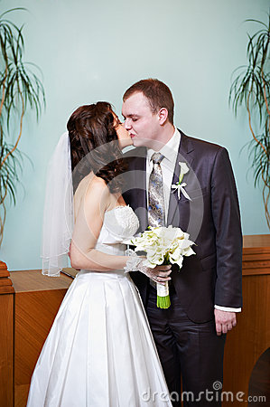Kiss bride and groom