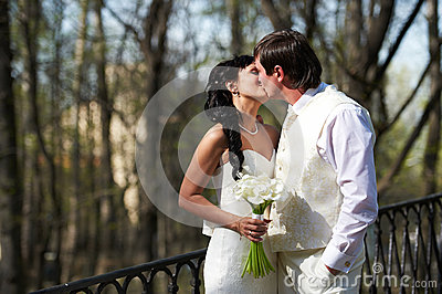 Kiss bride and groom in walking