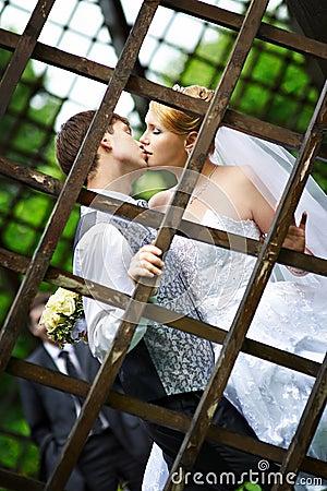 Kiss the bride and groom at wedding walk