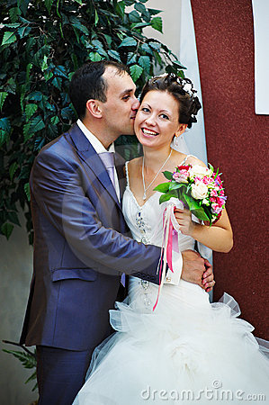 Kiss groom and happy bride